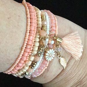 Jewelry - A PEACHY BRACELET GOLD TONE DAISY,FEATHER,TASSEL